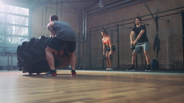 man doing workout with big tire - strongman stock videos & royalty-free footage