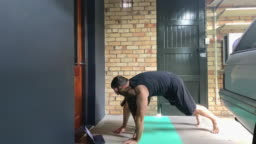 Man Doing Yoga at Home Being Disturbed By His Dog