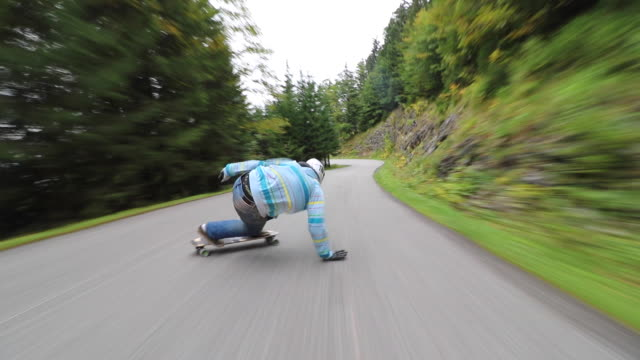 a man downhill skateboarding on a mountain road. - time-lapse - moving down stock videos & royalty-free footage
