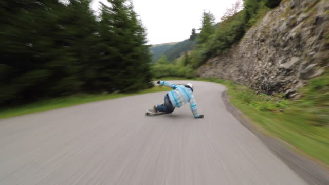 a man downhill skateboarding on a mountain road. - one young man only stock videos & royalty-free footage