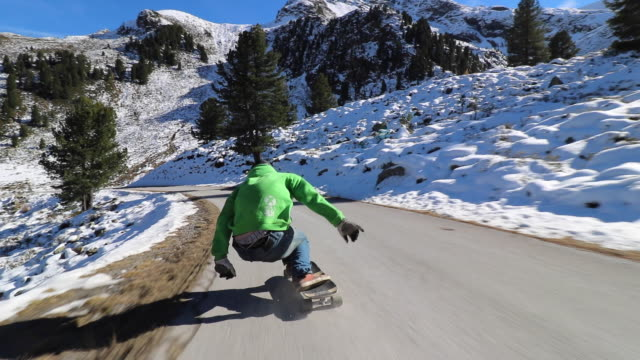 a man downhill skateboarding on a mountain road. - sweatshirt stock videos & royalty-free footage