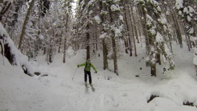 a man downhill skiing. - slow motion - ski jacket stock videos & royalty-free footage