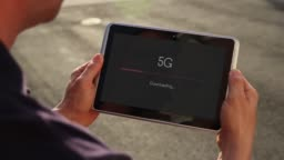 Man downloading Video Over 5G on a Tablet PC