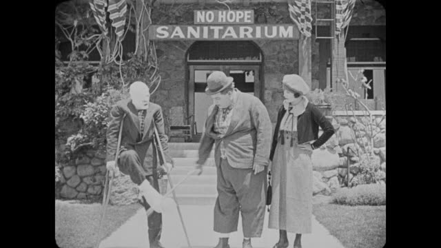 1918 man (fatty arbuckle) dragged into sanatorium by woman - plaster stock videos and b-roll footage