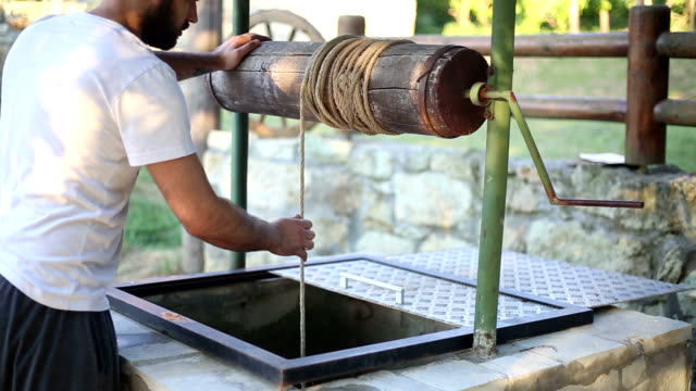 Man draw water from a well