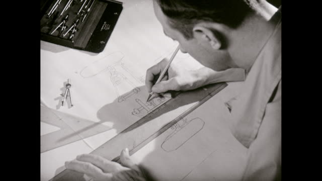 CU HA Man drawing blueprint / United States