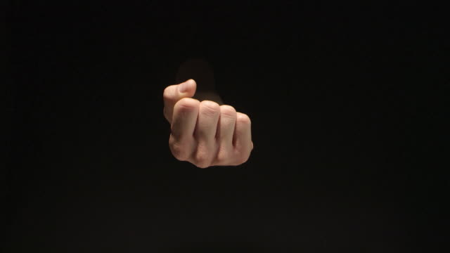 man drawing hand folded into fist. isolated on black - isolated colour stock videos & royalty-free footage
