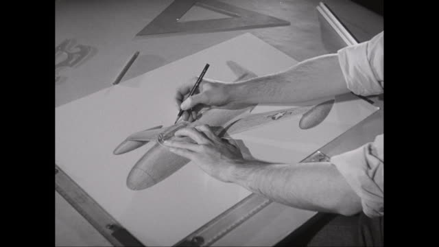 ms man drawing military airplane on drawing paper / united states - military aeroplane stock videos & royalty-free footage