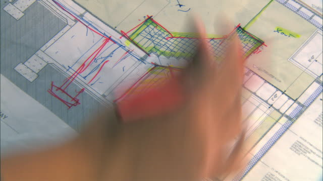 CU, Man drawing on architectural blueprint, close-up of hand