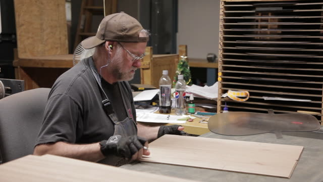 ms man drawing out body of guitar on flat board / nazareth, pennsylvania, usa - outline stock videos & royalty-free footage