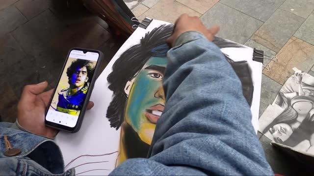 man draws a cartoon of late soccer superstar diego maradona in bogota, colombia, on november 25, 2020. - cartoon stock videos & royalty-free footage