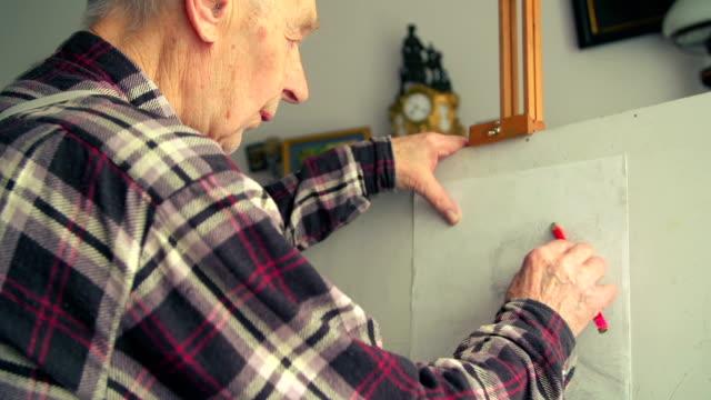 man draws self portrait - active seniors stock videos and b-roll footage