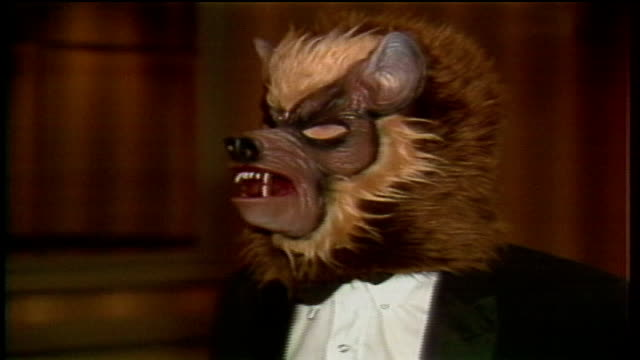 vídeos y material grabado en eventos de stock de man dressed as a werewolf tap dancing and handing out fliers at new music seminar - 1983