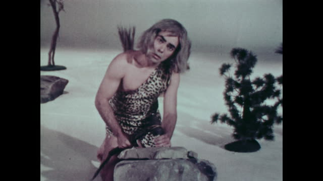 1967 man dressed as caveman chisels stone while voiceover discusses invention of writing - chisel stock videos and b-roll footage