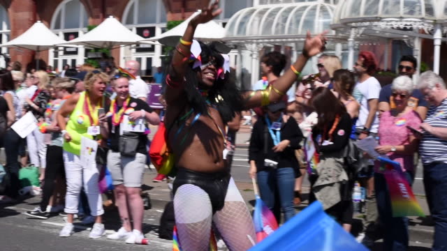 A man dressed in fishnets parades and dances in the Brighton Gay Pride Parade 2017