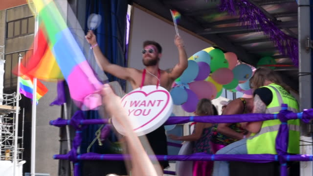 a man dressed up as a love heart sweet is dancing and engaging the crowd in the brighton gay pride parade 2017 in slow motion - fun stock videos & royalty-free footage