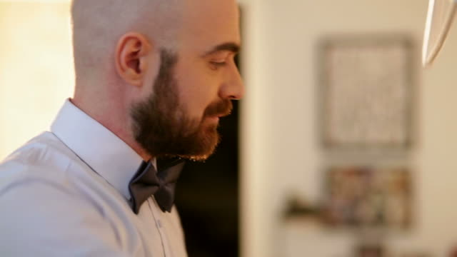 man dressed up for wedding ceremony - vollglatze stock-videos und b-roll-filmmaterial