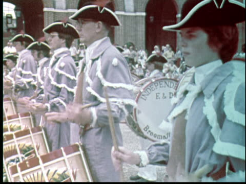 montage man dresses as uncle sam dances and tips hat. drummers in front of independence hall. mayor frank rizzo at outdoor podium speaks to crowd. girl scouts marching with flags. pan up independence hall tower. / philadelphia, pennsylvania, usa - independence hall stock videos & royalty-free footage