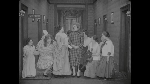 1917 man (al st. john) dresses as woman so he can join fellow former clerk (alice lake) and disguised butcher (fatty arbuckle) at girls school - 1917 stock videos & royalty-free footage