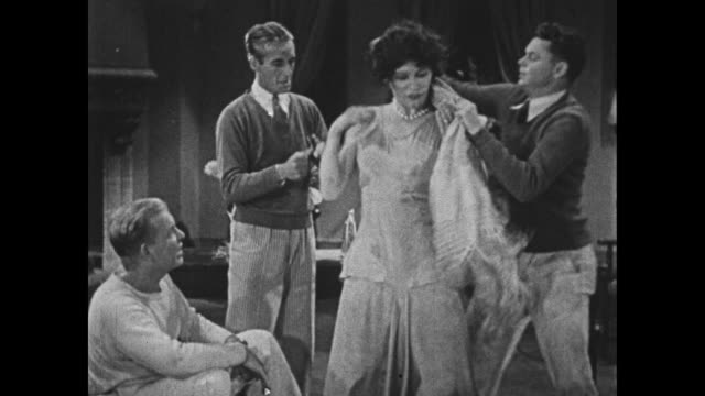 1932 a man, dressing in drag, puts the finishing touches on his outfit - look alike stock videos and b-roll footage
