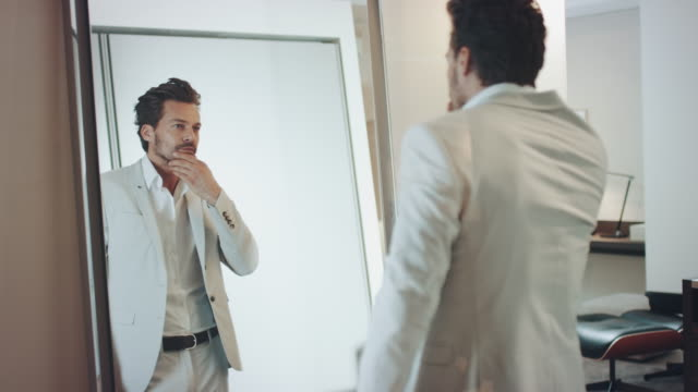man dressing - mirror stock videos & royalty-free footage