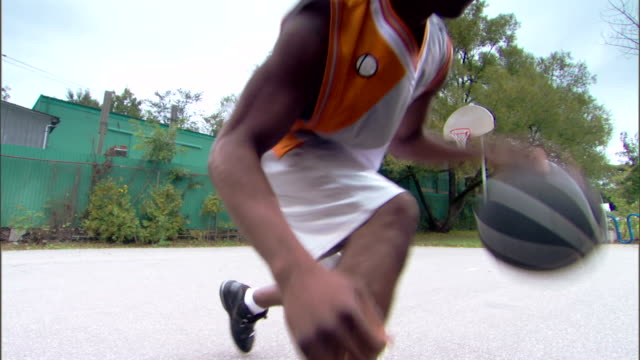 man dribbling basketball - see other clips from this shoot 1281 stock videos and b-roll footage