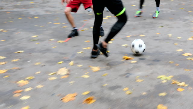 Man dribbling football towards soccer goal