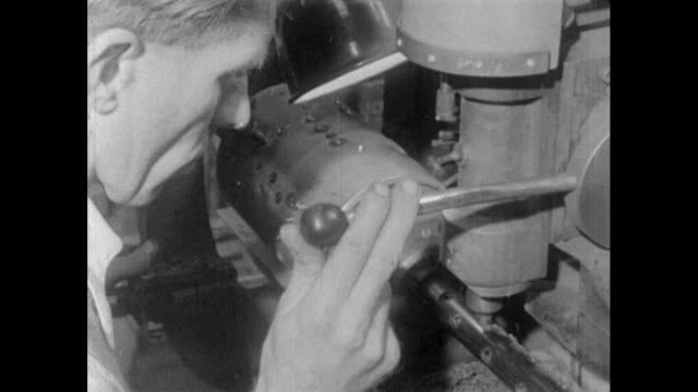 man drills holes in clarinet body; 1956 - drill stock videos & royalty-free footage
