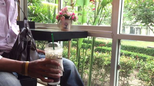 man drink ice coffee in the store - coffee drink stock videos & royalty-free footage