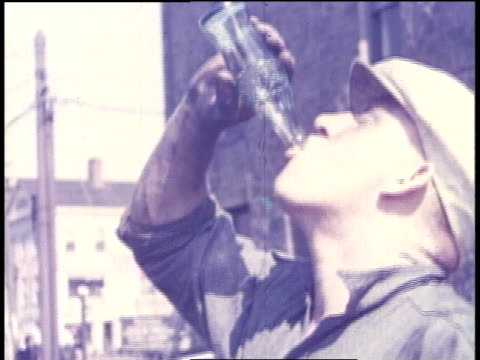 1938 CU man drinking a bottle of soda / Hartford, Connecticut, United States