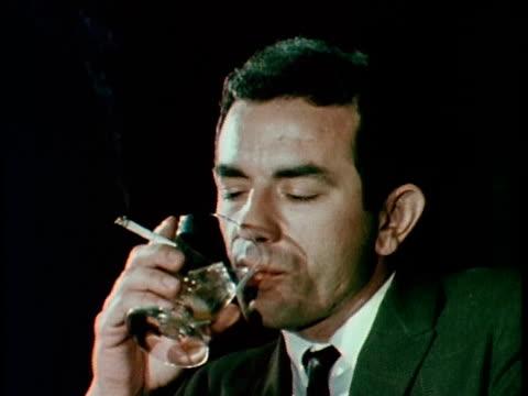 1967 MONTAGE Man drinking and smoking at bar, Los Angeles, California, USA, AUDIO