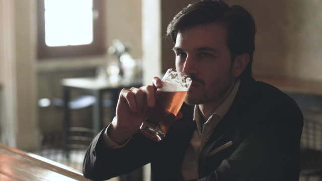 man drinking beer in a bar - beer alcohol stock videos & royalty-free footage