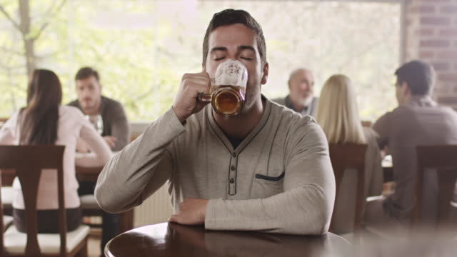 man drinking beer - temptation stock videos & royalty-free footage