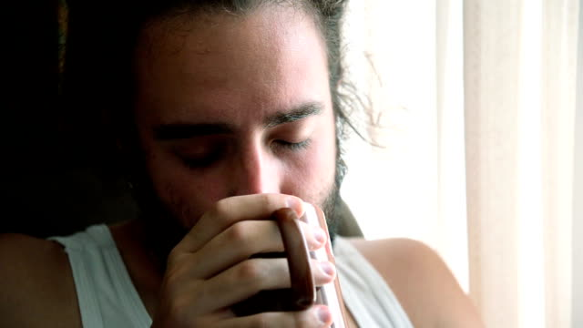Man drinking coffee.