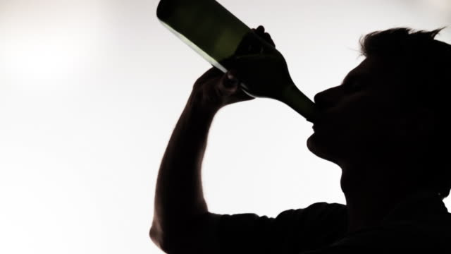 hd: man drinking from wine bottle - alcohol abuse stock videos & royalty-free footage