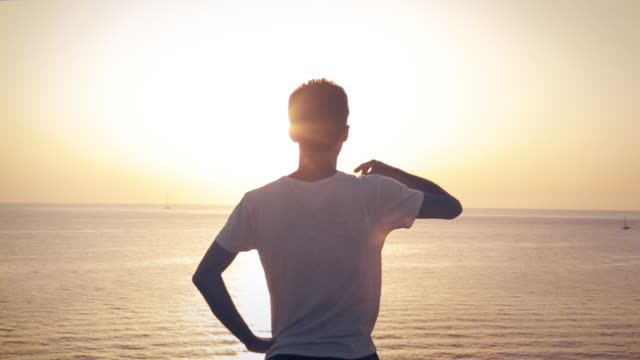 man drinking in front of the sunset with sea view - sea robin stock videos & royalty-free footage