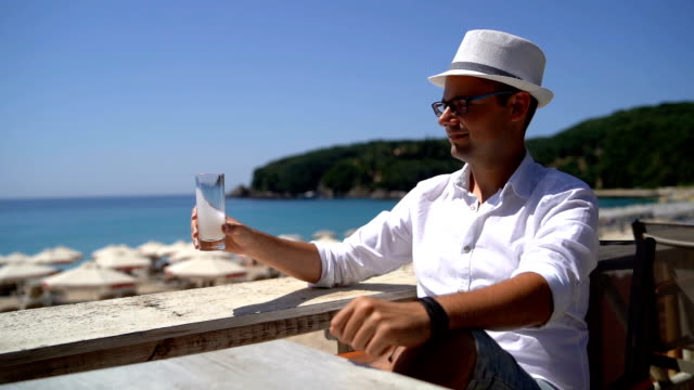 man drinking on beach terrace - balcony stock videos & royalty-free footage