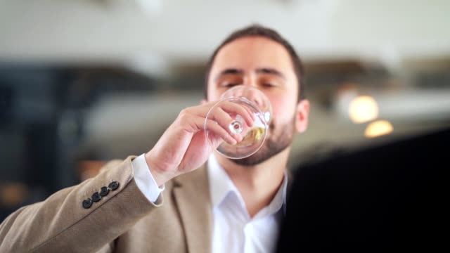 man drinking sparkling wine in a restaurant - viniculture stock videos & royalty-free footage