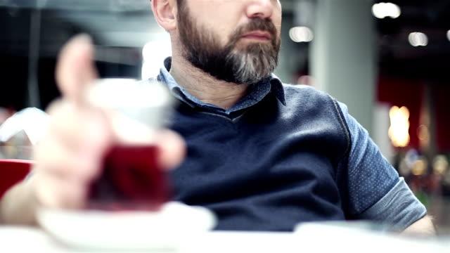Man drinking tea at cafe