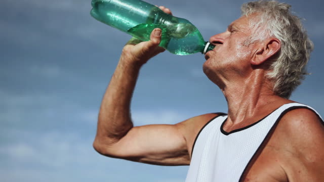 CU Man drinking water from bottle / Corsept, Loire-Atlantique, France