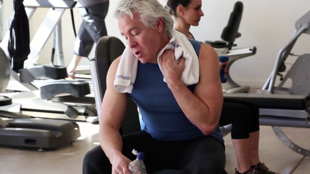 ms man drinking water in break at gym / santa fe, new mexico, united states - exercise equipment stock videos and b-roll footage