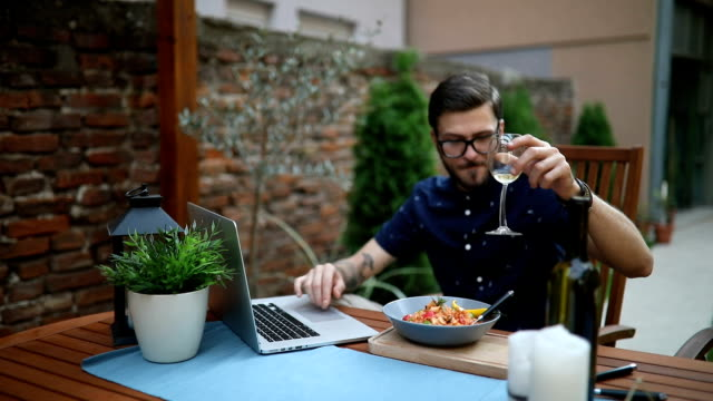 man drinking wine and working outdoors - risotto stock videos & royalty-free footage