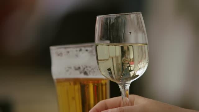 CU R/F Man drinking wine in restaurant / Paris, France