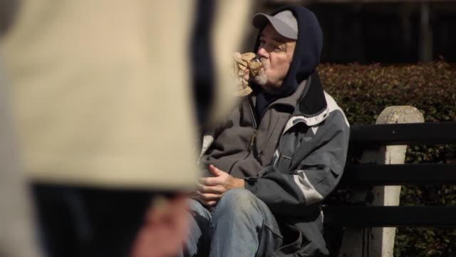 Man Drinks in Urban Setting - WS Multi Clip