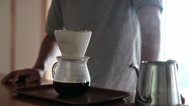 man dripping brewed coffee on kitchen counter - preparing food stock videos & royalty-free footage