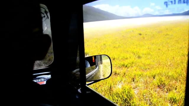 hd ms: man drive a car on desert volcano - bromo tengger semeru national park stock videos & royalty-free footage