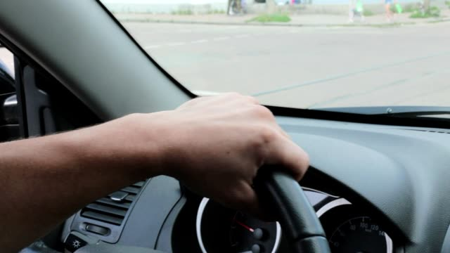 a man drives a car in the city. - chauffeur stock videos and b-roll footage