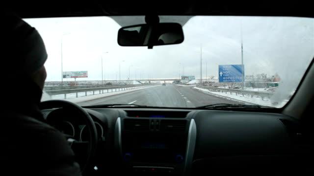 vídeos de stock e filmes b-roll de man drives a car on the highway. - dentro
