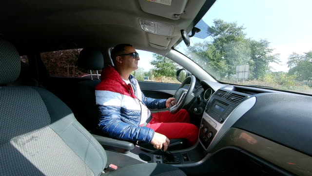 a man drives a car on the highway. - ukrainian ethnicity stock videos and b-roll footage