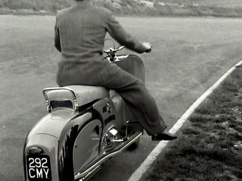 a man drives the new dayton albatross motor scooter - 試運転点の映像素材/bロール